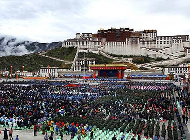 Ethnic Tibetans and residents gather in front of the Potala Palace to join the celebration of the 60th anniversary of Tibet's peaceful liberation in Lhasa