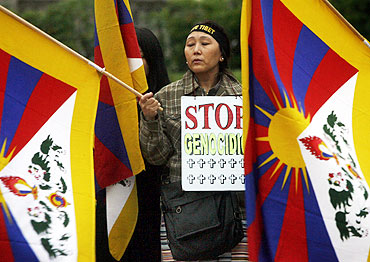 An ethnic Tibetan woman protests against Chinese rule in Tibet