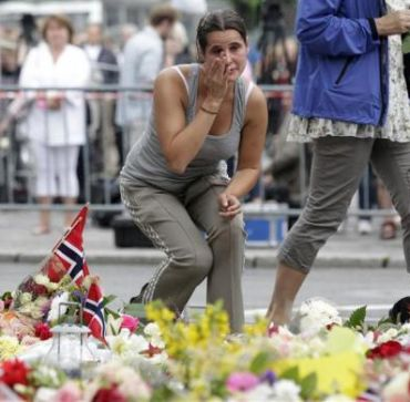 A mourner breaks out in tears following a memorial service in the Oslo cathedral
