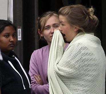 People react as they gather in front of a hotel, where relatives of victims and survivors of a shooting which took place at a meeting of the youth wing of Norway's ruling Labour Party on Utoeya island have gathered, in Sundvollen