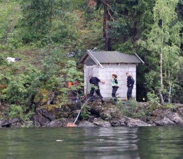 Police members search for evidence on Utoeya island