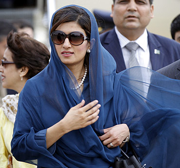 Pakistan's Foreign Minister Hina Rabbani Khar arrives at the airport in New Delhi