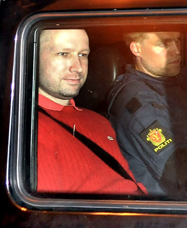 Breivik (rear seat) leaves the courthouse in Oslo