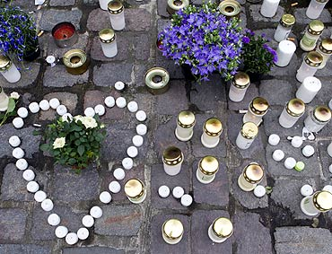 Candles and flowers placed in tribute to the victims