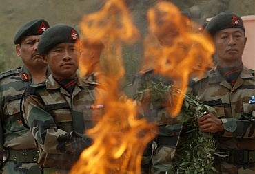 Army soldiers take part in a wreath laying ceremony at the war memorial during Vijay Diwascelebration in Drass