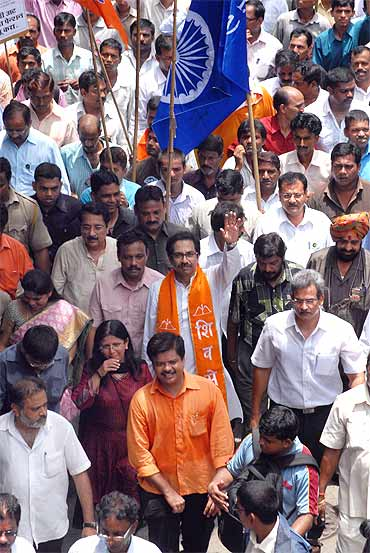 Shiv Sena Executive President Uddhav Thackeray participates in a morcha for the cause of textile mill workers