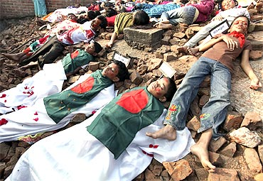 Children enact mock genocide in Dhaka to pay tribute to victims of the 1971 war