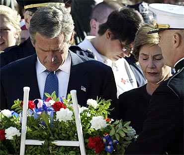 A file photo of former US President George W Bush and First Lady Laura Bush praying at Ground Zero