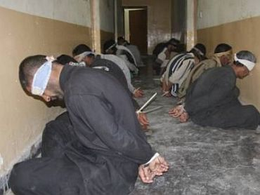 Blindfolded inmates at the Tadmor military prison in Palmyra, Syria