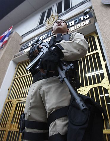 A guard stands at Bangkwang Central Prison on the outskirts of Bangkok
