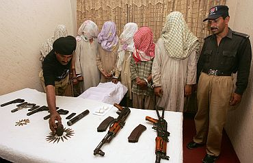 Pakistani police display six captured militants from Lashkar-e-Jhangvi in Karachi