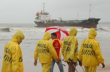 Cops man the beach where cargo vessel M V Pavit ran aground