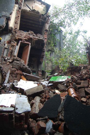 What's left of a three-story building in Kurla West that collapsed due to heavy rains