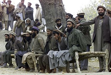 File picture show captured Al Qaeda members sitting on a bench as they are presented to the media in Tora Boraa