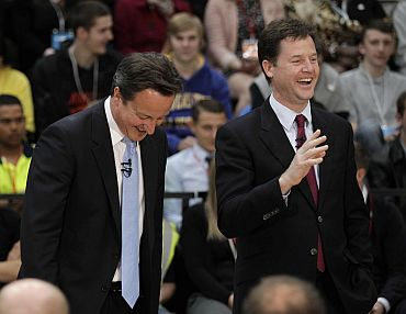 Britain's Prime Minister David Cameron and Deputy Prime Minister Nick Clegg