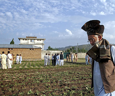 Residents surround the compound where US commandos killed Osama bin Laden in Abbottabad