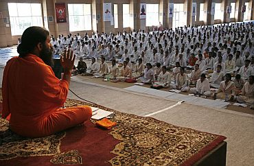 Baba Ramdev speaks duirng a yoga camp in Haridwar