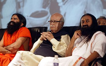Baba Ramdev with Sri Sri Ravi Shankar and BJP leader L K Advani
