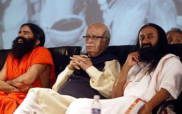 Baba Ramdev with senior BJP leader L K Advani and spiritual guru Sri Sri Ravi Shankar in a function in Bhopal