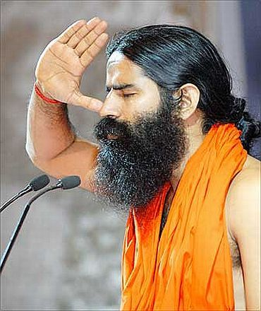 Baba Ramdev gestures during his yoga camp in New York