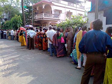 People turn out in heavy numbers in front of a polling booth in Kolkata