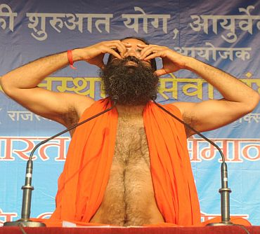 Baba Ramdev teaches yoga at a camp