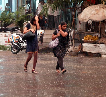 Mumbaikars run for shade as season's first spell of rains surprised the city on Thursday evening