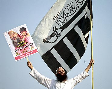A supporter holds an image of Al Qaeda leader Osama bin Laden during an anti-American rally in Lahore