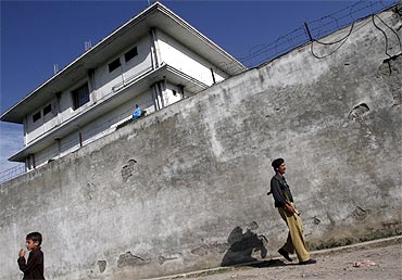 A policeman walks in front of the compound where al Qaeda leader Osama bin Laden was killed in Abbottabad