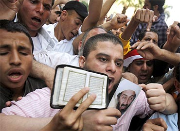 Protestors hold a picture of Osama bin Laden during a rally in Cairo