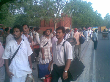 Non-New Delhi residents were seen scampering to catch buses to their destinations after they were evicted by the cops