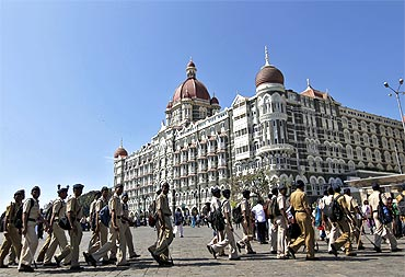 Policemen deployed at the Taj Mahal Hotel