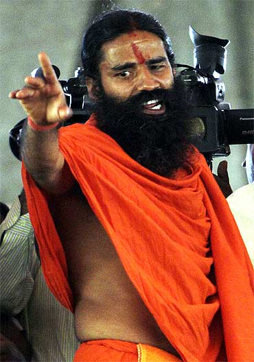 Swami Ramdev speaks during a news conference