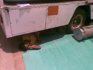 A tired Ramdev support sleeps under a truck on Saturday