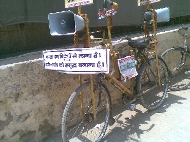 A bicycle carrying anti-corruption messages is parked at the ground