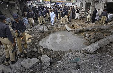 Security officials survey the site of a suicide bomb blast in Quetta, Pakistan on April 7, which killed at least one man and wounded four others