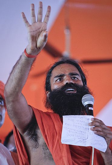 Yoga guru Ramdev addresses his supporters at the Ramlila grounds in New Delhi on Friday