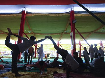 Supporters of Baba Ramdev practice yoga at Ramlila grounds in New Delhi on Friday
