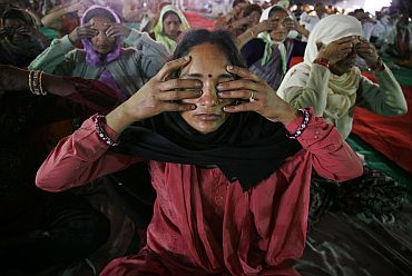 File picture of women practicing yoga during Baba Ramdev's camp in Haridwar