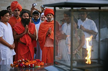 Baba Ramdev offers prayers at the Mahatma Gandhi memorial at Rajghat in New Delhi on Friday