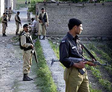 Army soldiers keep guard outside the compound where Al Qaeda leader Osama bin Laden was killed in Abbottabad