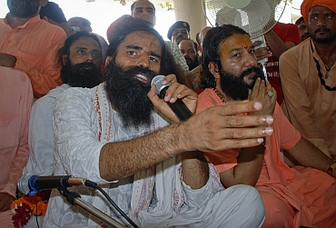 Ramdev speaks during a news conference in Haridwar