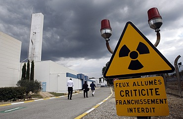 A warning sign is posted next to of the building which houses the plutonium fuel fabrication facility in Cadarache, southern France