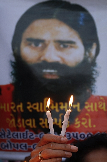 Supporters of Ramdev hold candle light vigil