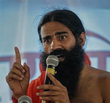 Yoga guru Swami Ramdev addresses his supporters during his fast against corruption