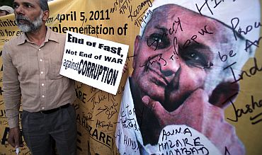 A supporter of social activist Hazare holds a placard during a campaign against corruption