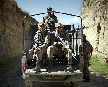 Pakistani soldiers keep guard along a road in Bajaur Agency, one of their main nerve centres of Taliban and Al Qaeda