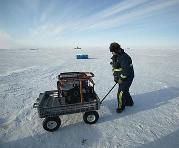 A participant pushes a generator towards a refueling station
