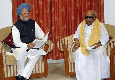 Upset DMK won't pull out from UPA govt for now