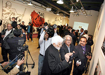 M F Husain in an exhibition of his paintings in US